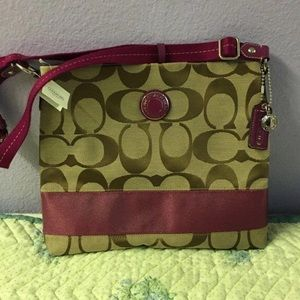 Berry strap and beige coach bag